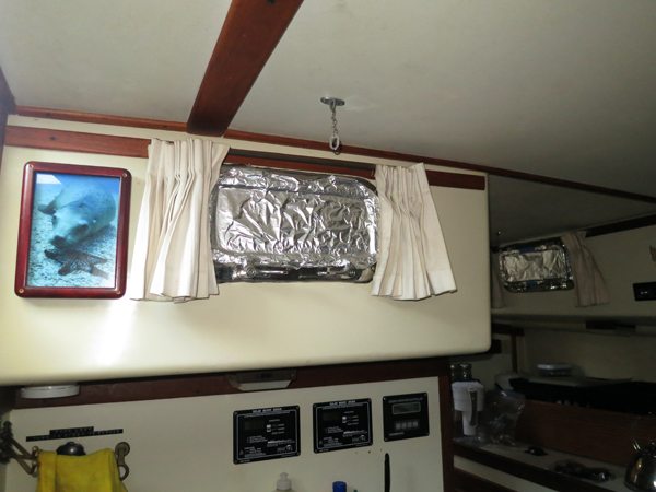 We foiled portholes and hatches to reflect the sun's rays