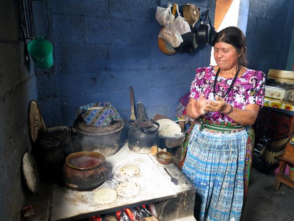Magdalena making the music of morning tortillas