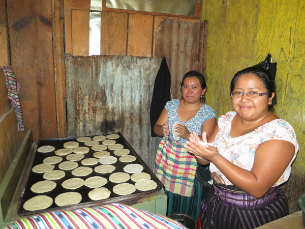 Lourdes selling tortillas in the market in the mornings before class